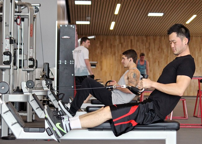 Students use weight machine to work out