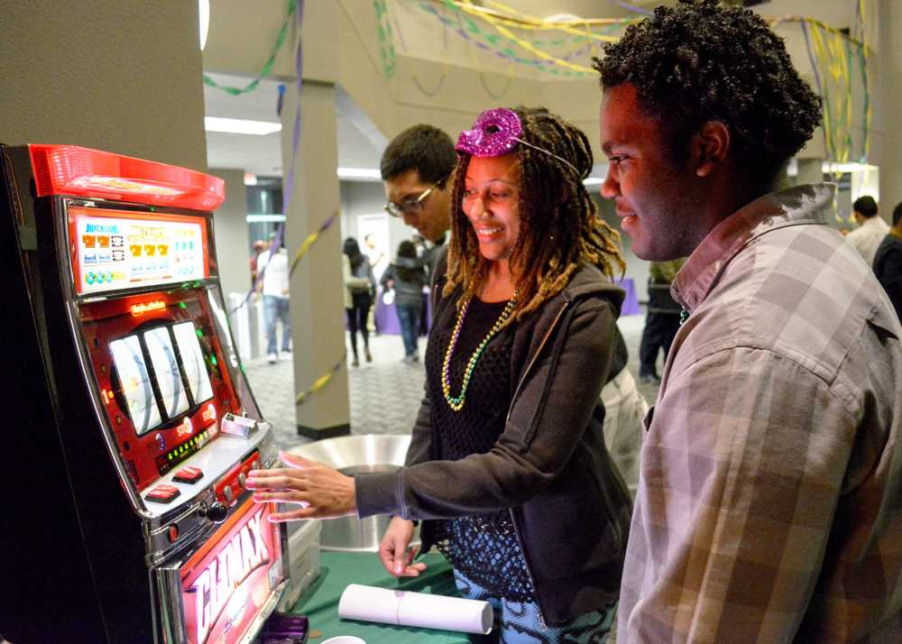 Two students play with slot machines