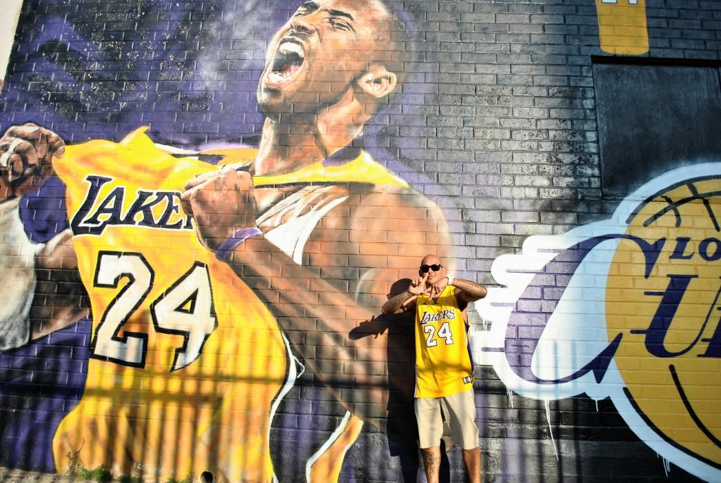 Fan poses in front of Kobe Bryant mural
