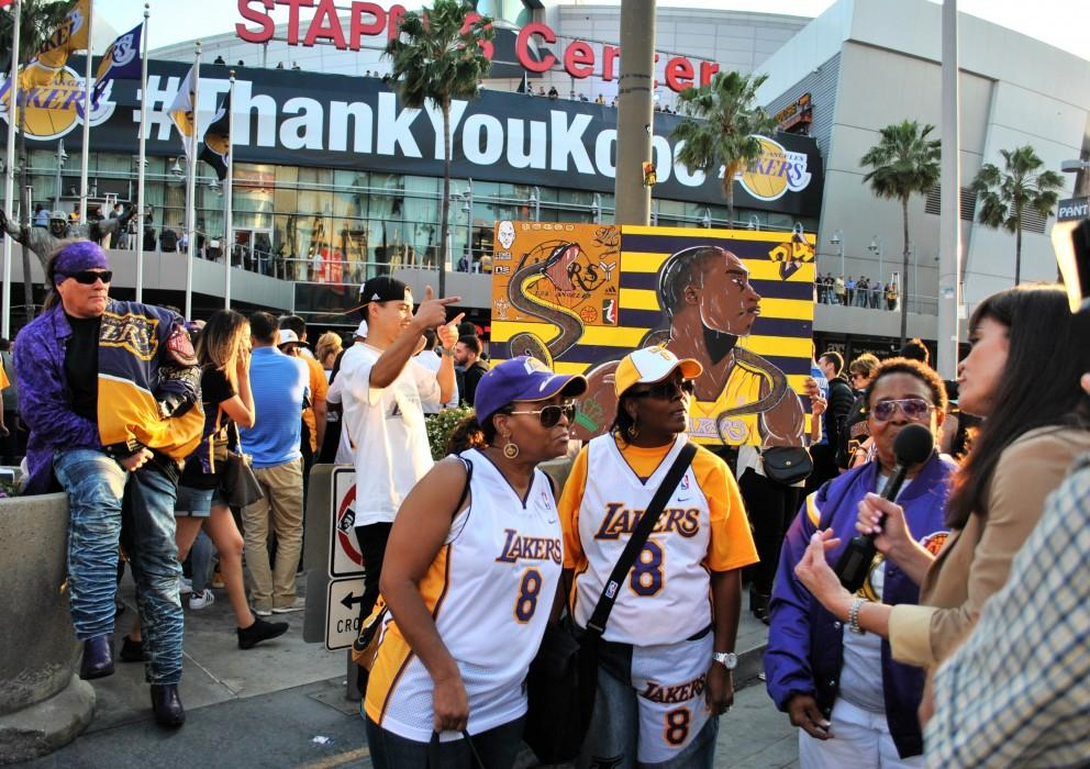 Crowds of fans stand outside Staples Center