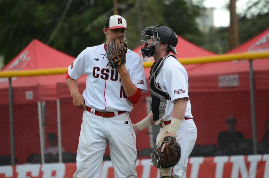 CSUN baseball athletes talk next to one another