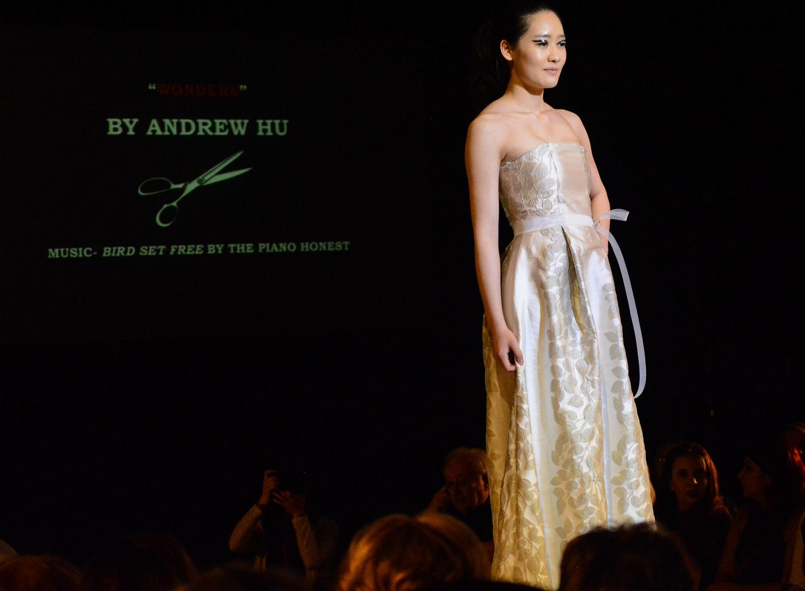 Linyan Du pictured walking the runway