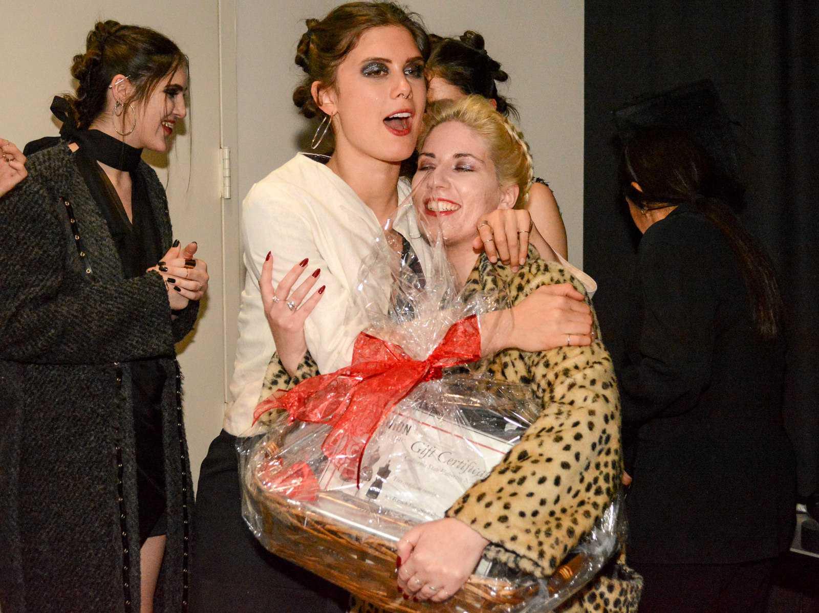 Model hugs designer