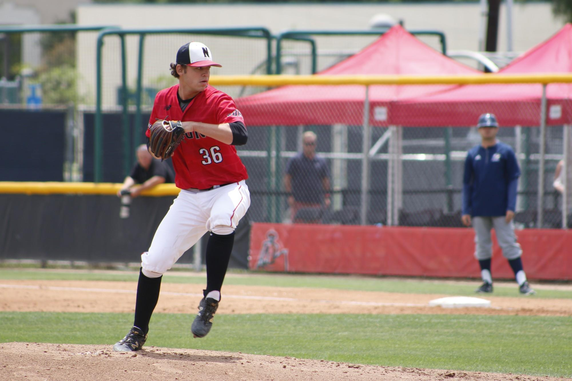CSUN baseball player pitches the ball