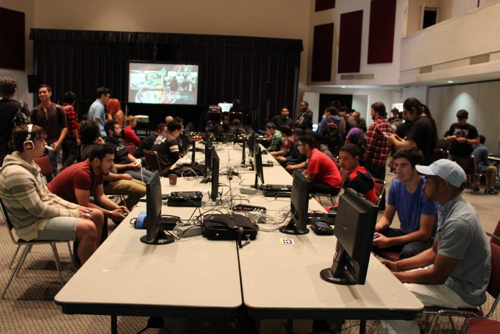 Members of the anime club are sitting at computers playing various video games