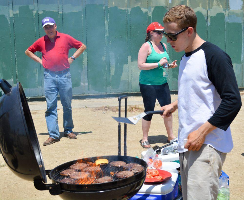 man grills burgers