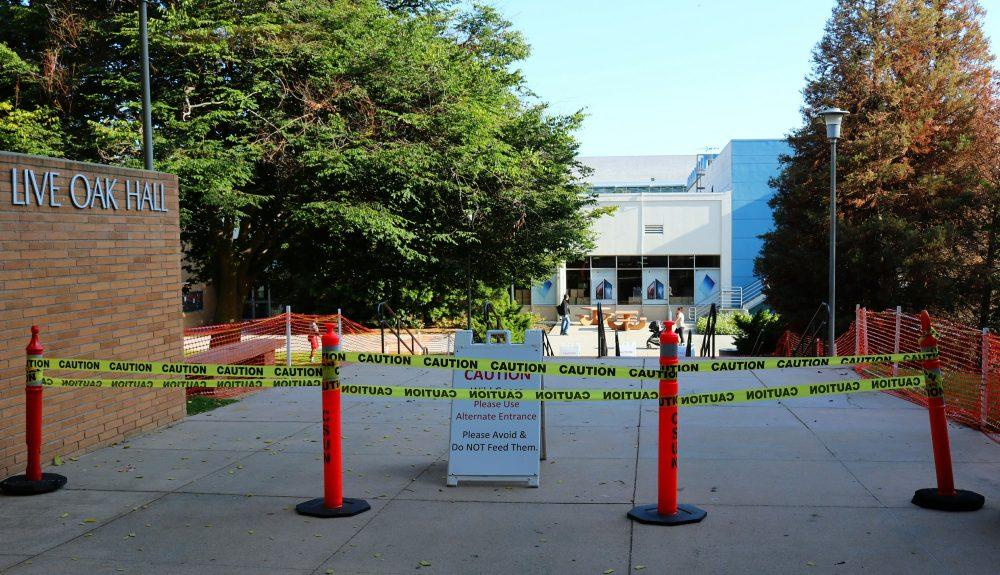 Live Oak Hall entrance is blocked off with caution tape