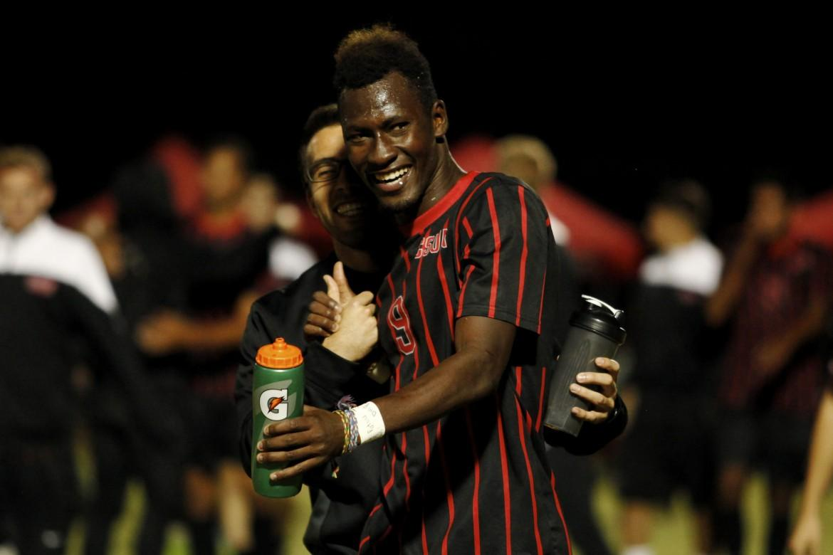 Sophomore+forward+Papi+Diouf+celebrates+with+a+member+of+the+CSUN+staff+after+scoring+the+game-winning+goal+against+UC+Riverside.+%28File+photo%29