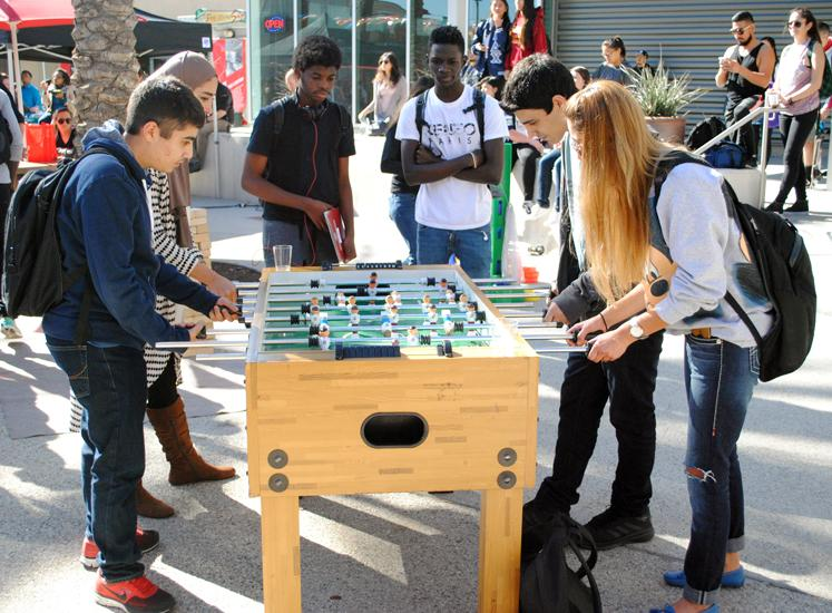 Students play foosball