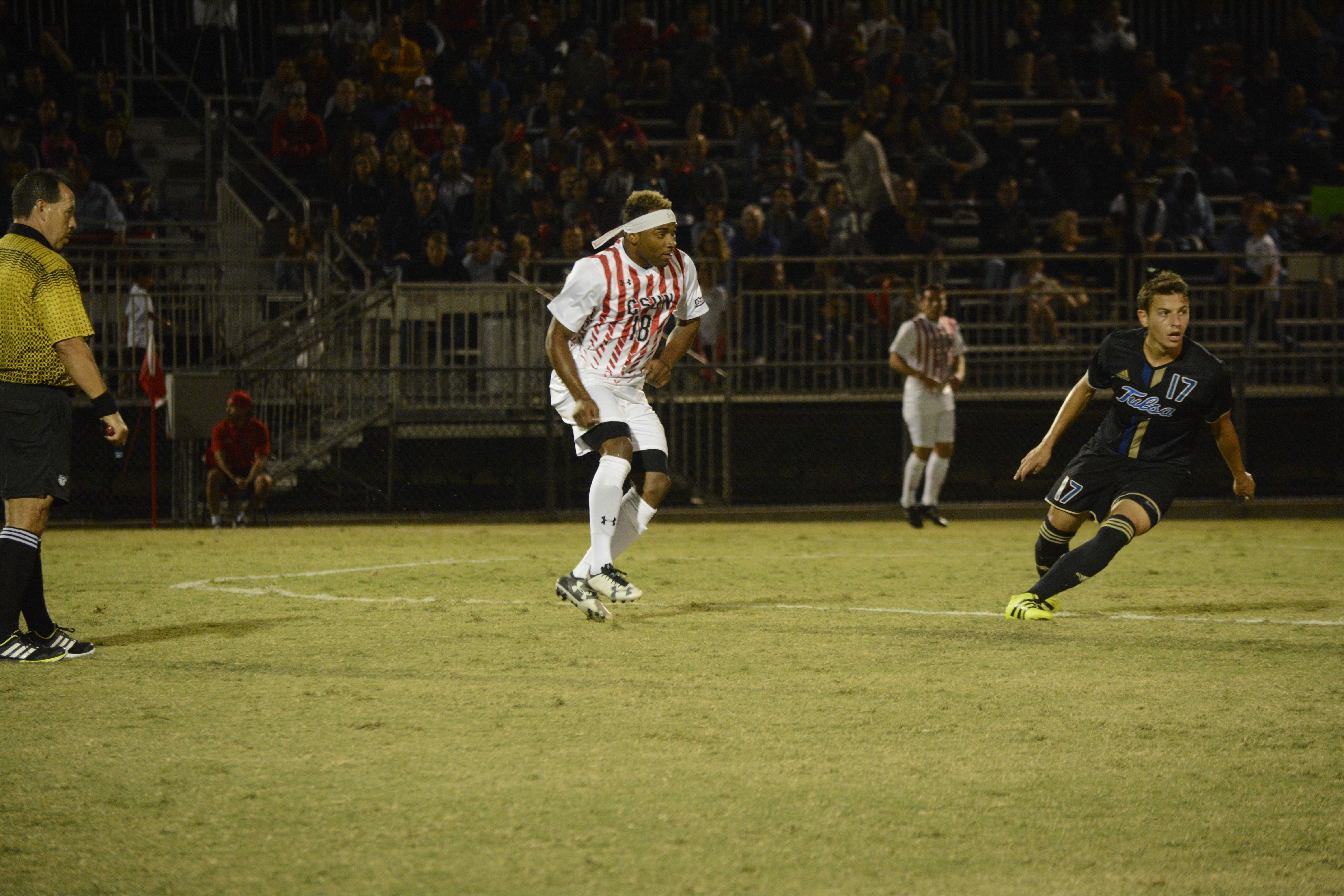 CSUN player watches midfield