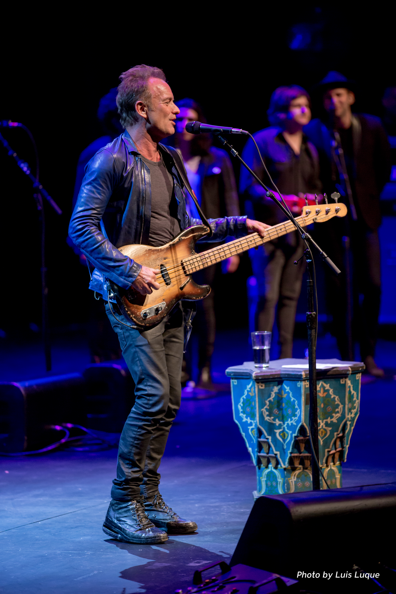 Sting shown playing guitar and singing