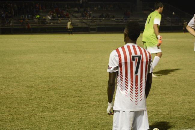 Papi Diouf stretches during half time before going back on the field. Photo Credit: Kendall Faulkner/ The Sundial