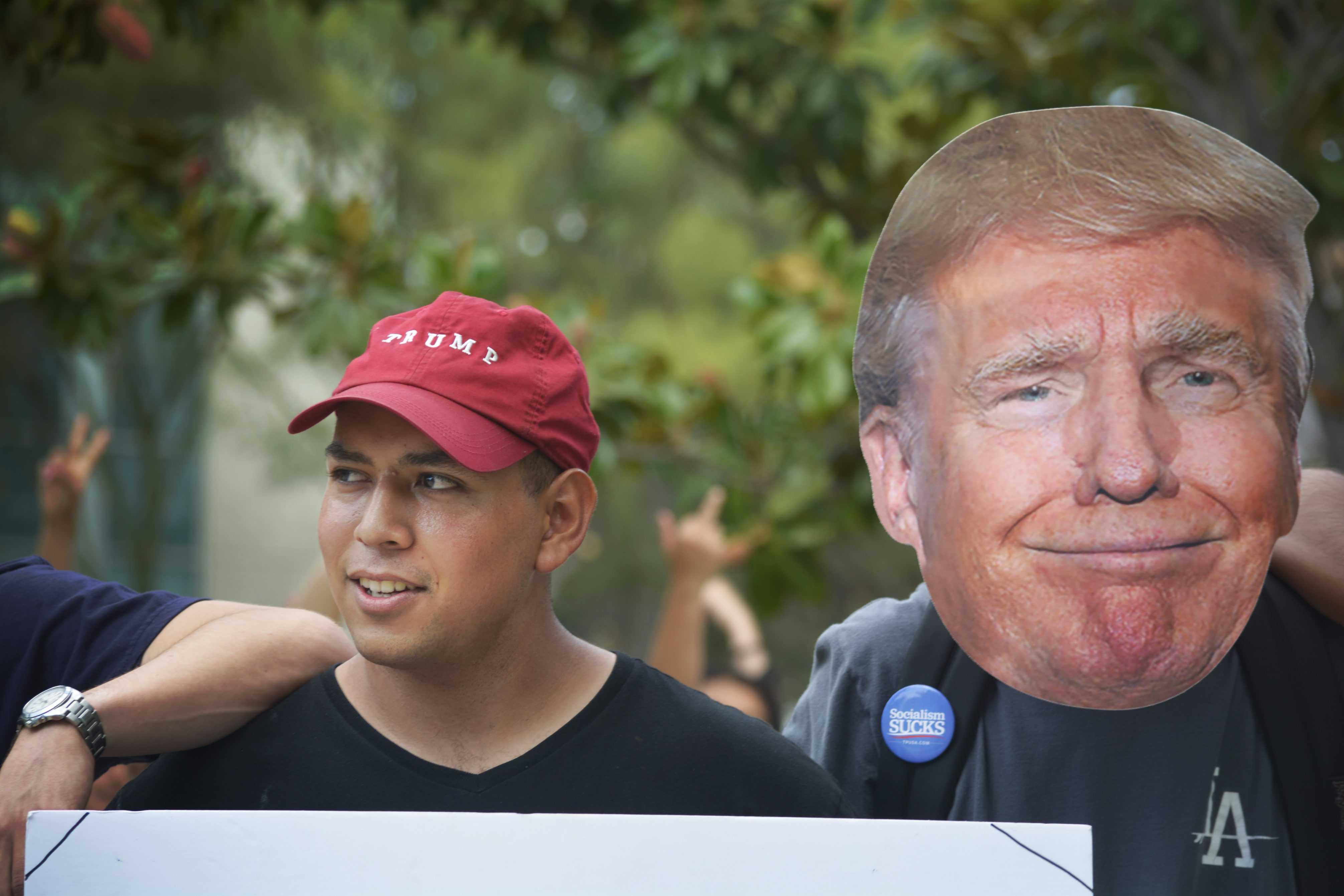 Man wears donald trump mask