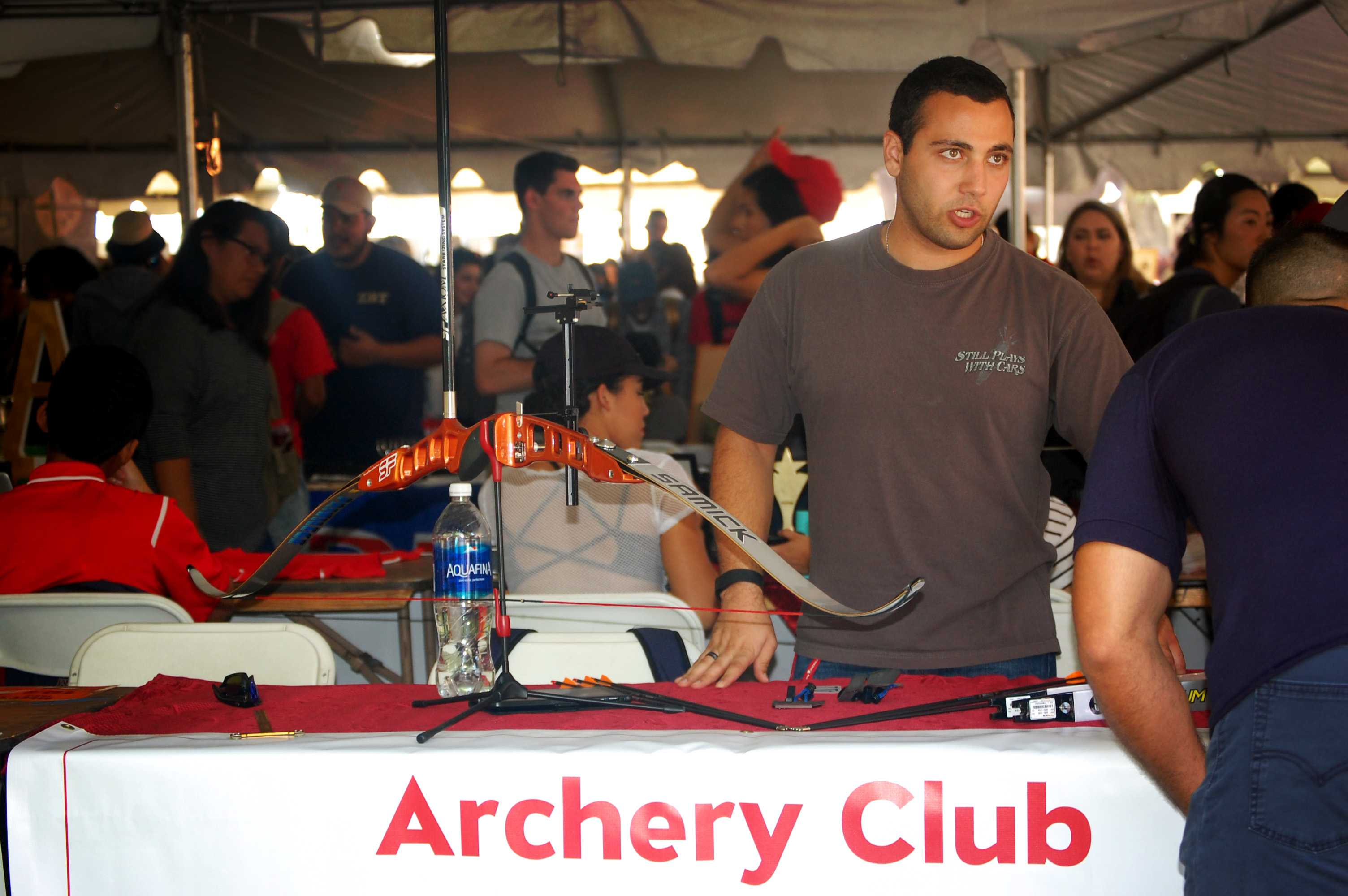 Student+speaks+to+people+at+archery+club+booth