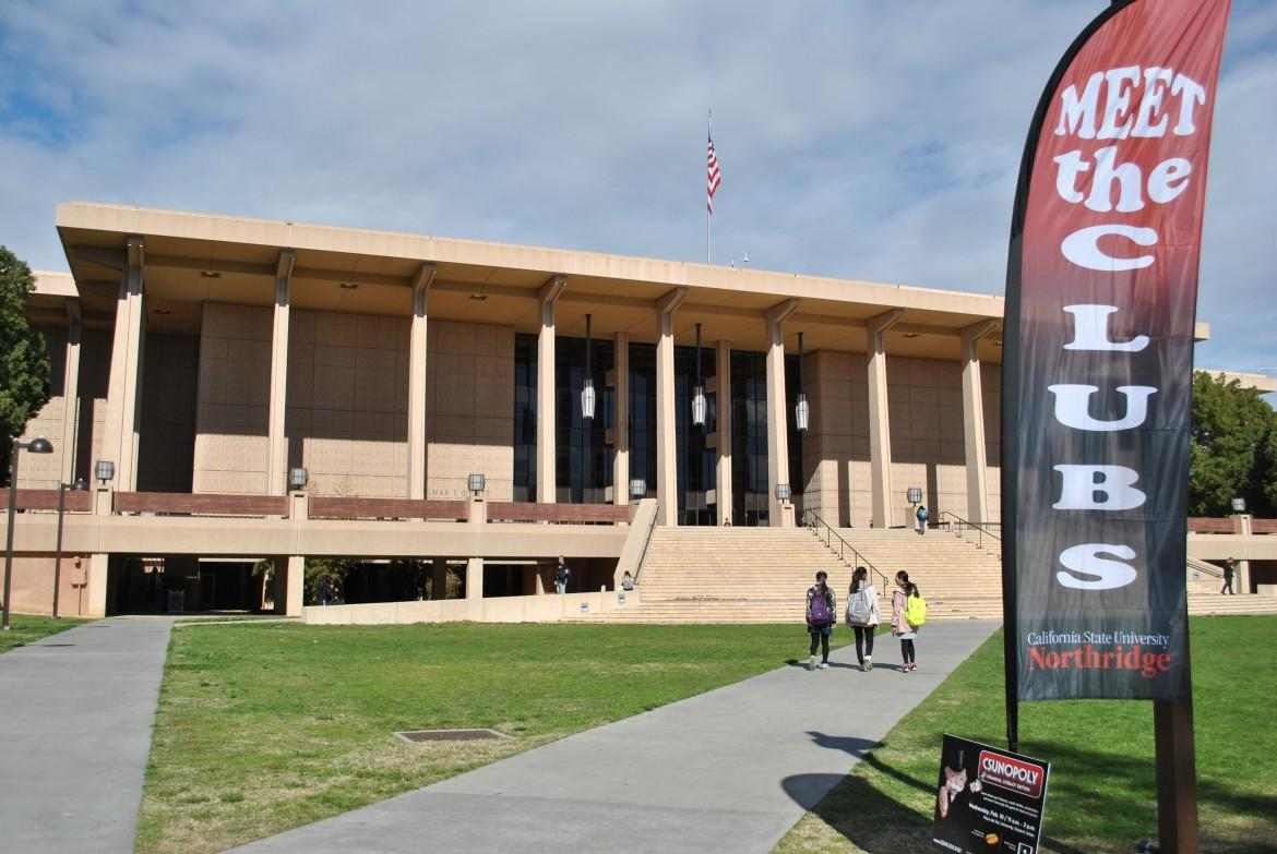 "CSUN's Oviatt Library pictured with the banner that says, ""meet the clubs"""