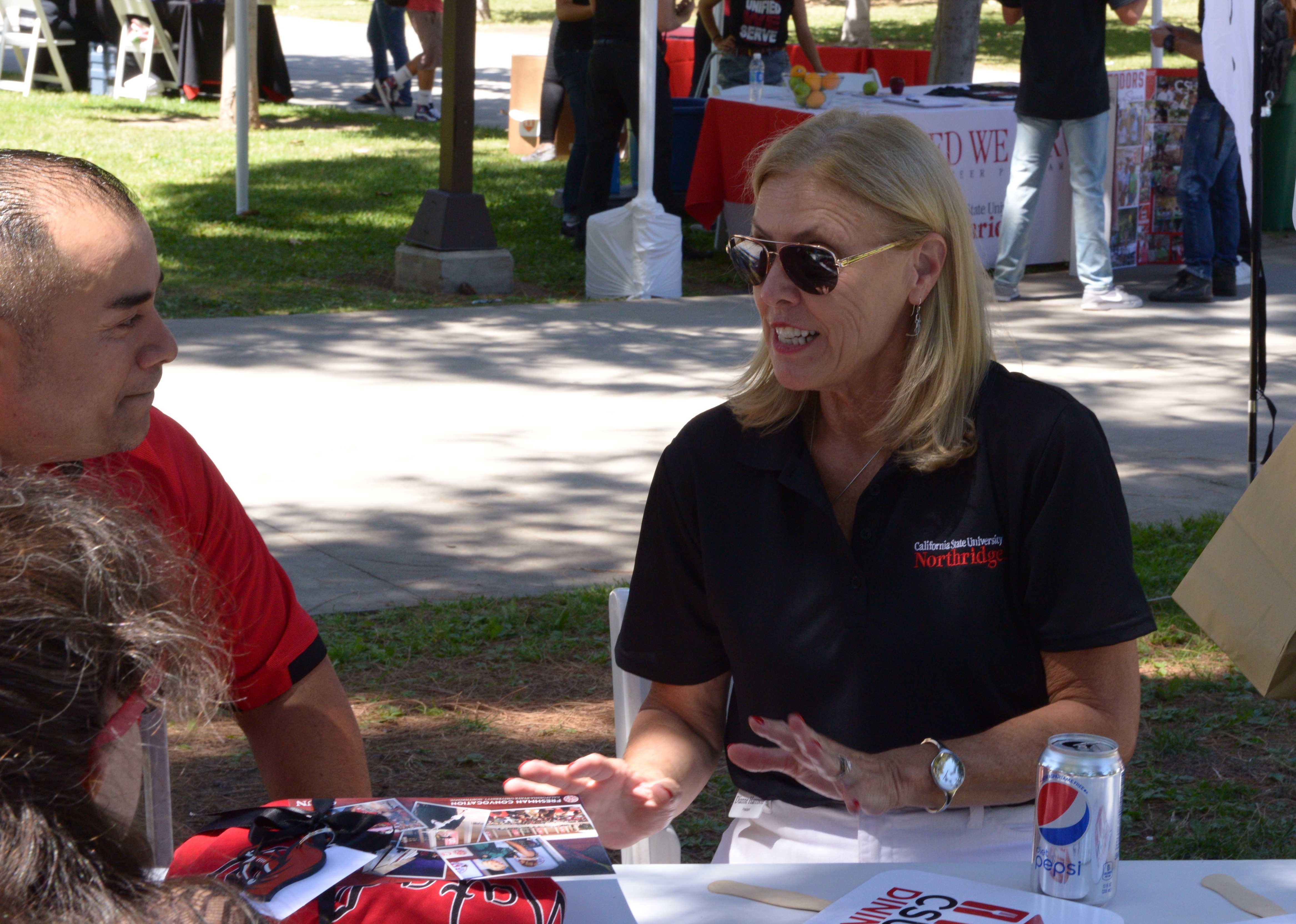 CSUN president Diane Harrison speaks with staff members