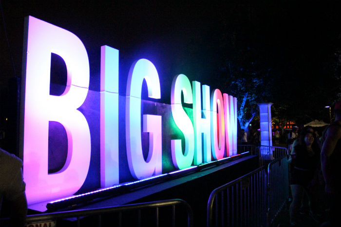 "Large, lit-up letters read ""big show"""