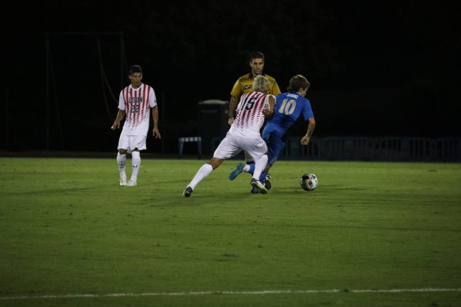 Senior Fernando Samayoa battles for the ball against UCLA. Photo Credit: Kendall Faulkner