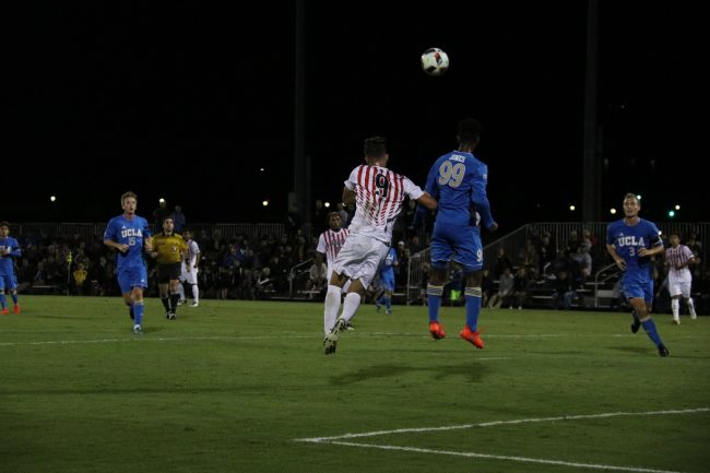 Freshman Bar Shem Tov is going for a header against UCLA. Photo Credit: Kendall Faulkner