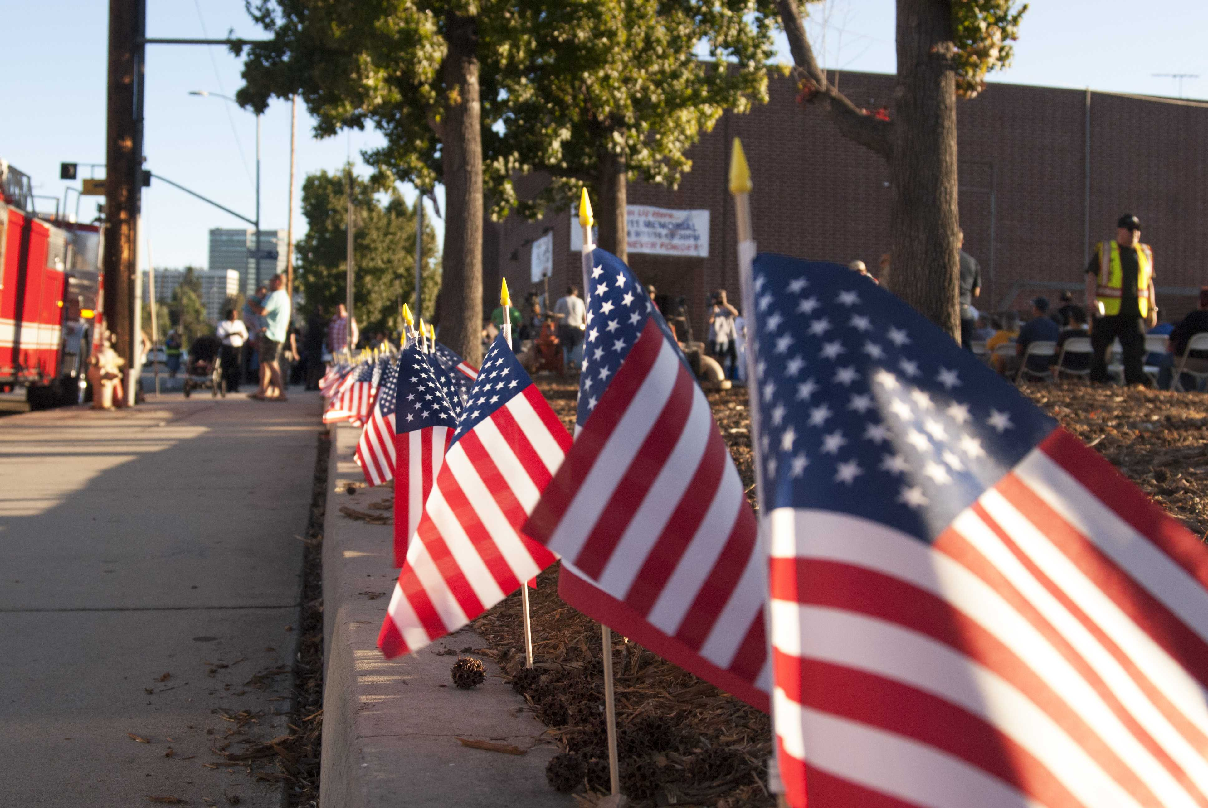 American flags line the perimeter of the LA fire department