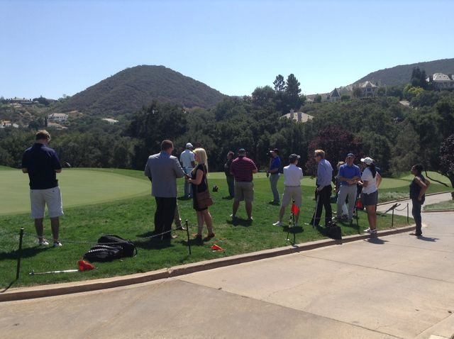Member of the media gather around at the golf course at the Sherwood Country Club. Photo Credit: Sundial Evelyn Hernandez