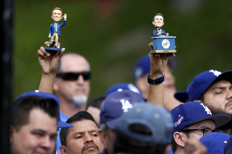 Dodger+fans+hold+up+bobble-head+dolls
