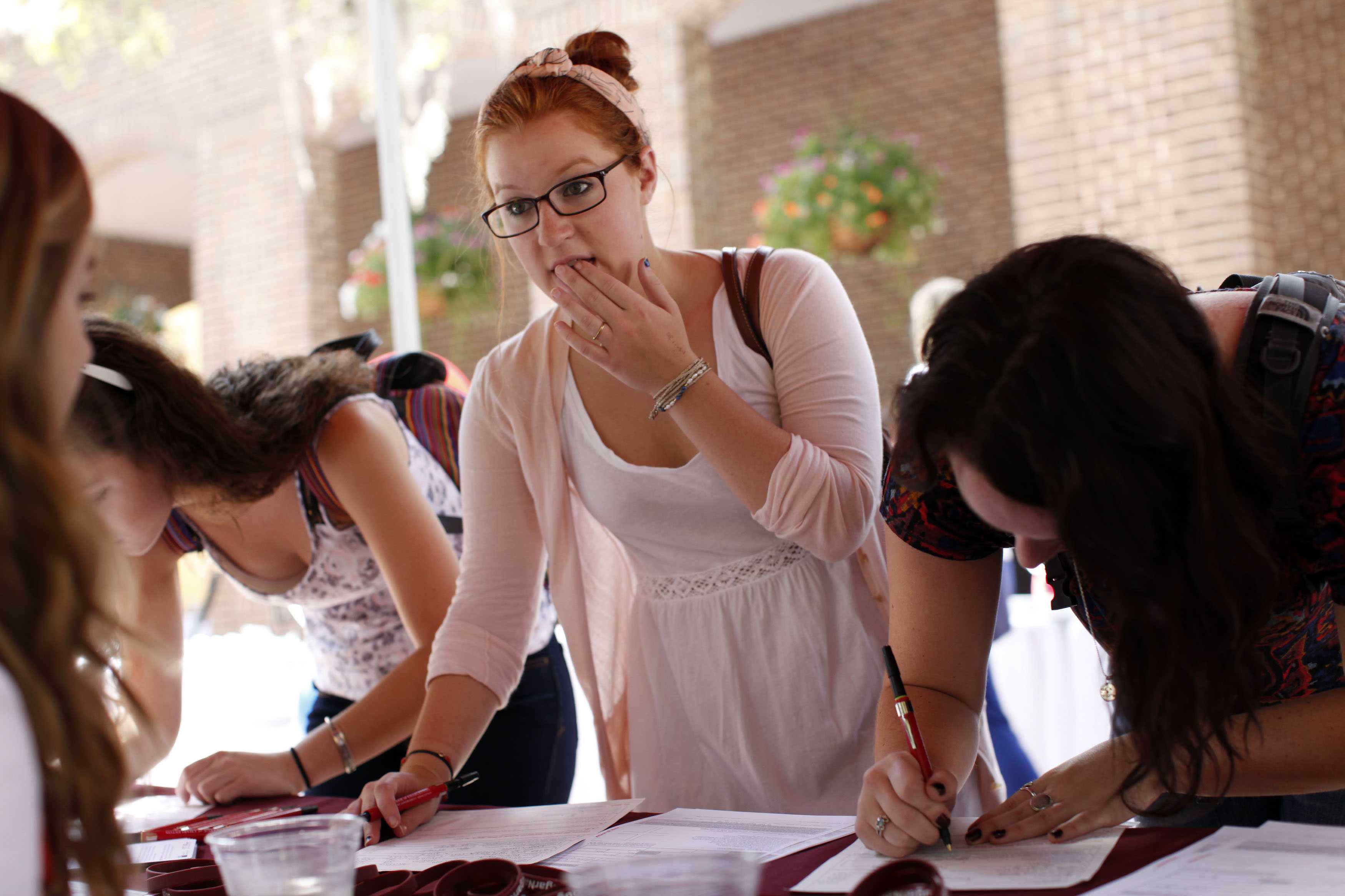 Students pictured registering to vote