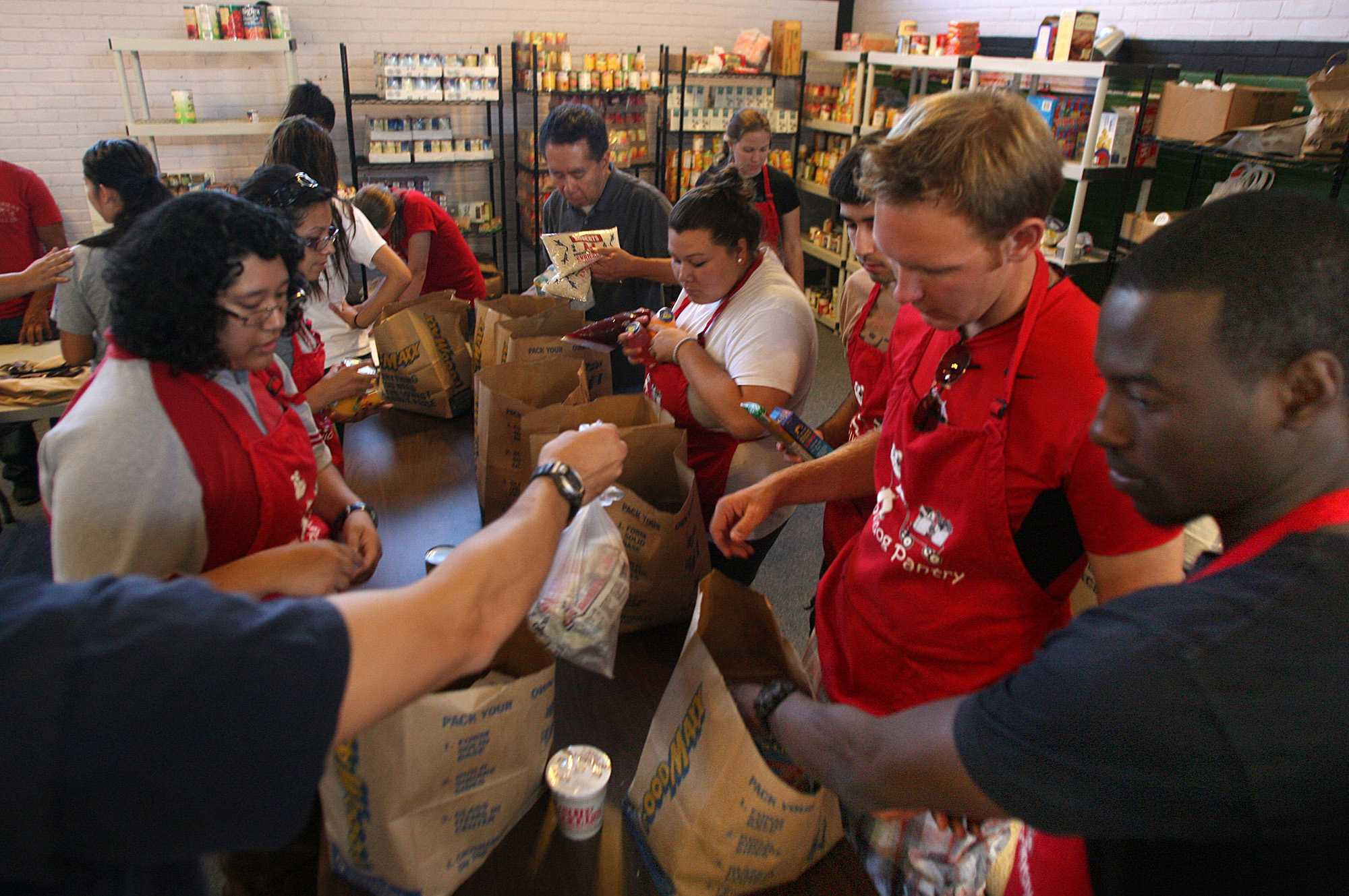 Fresno state university students pack bags of food