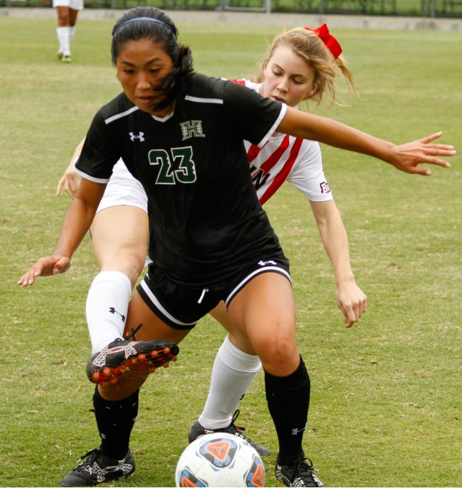 CSUN sophomore Kirsten Von Meter, back, battles Hawaii player Lauren Takai for the ball during Sunday afternoon's game at Matador Field. CSUN won the match in double overtime. Photo credit: Ricardo Varela/ The Sundial