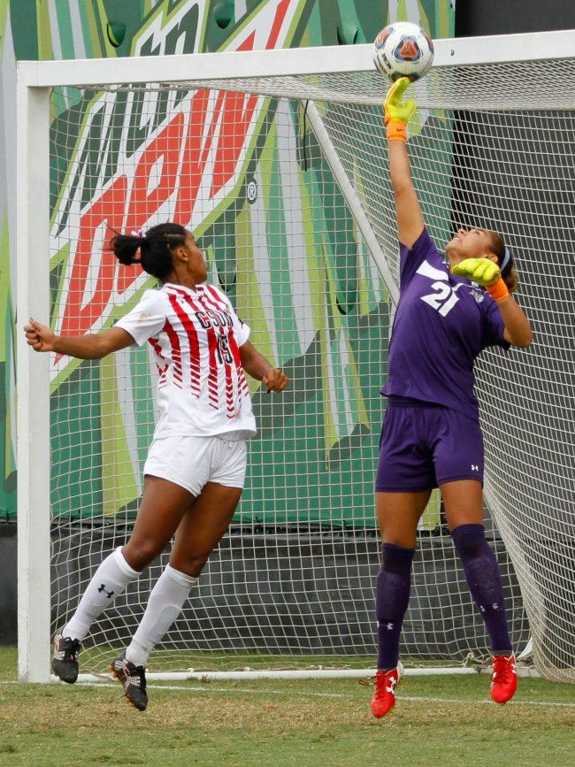 Hawaii goaltender Monk Berger, right, reaches high to stop a CSUN scoring chance during Sunday afternoon's game at Matador Field. Berger made 6 saves against the Matadors, but the Rainbow Wahine lost in double overtime. Photo credit: Ricardo Varela/ The Sundial