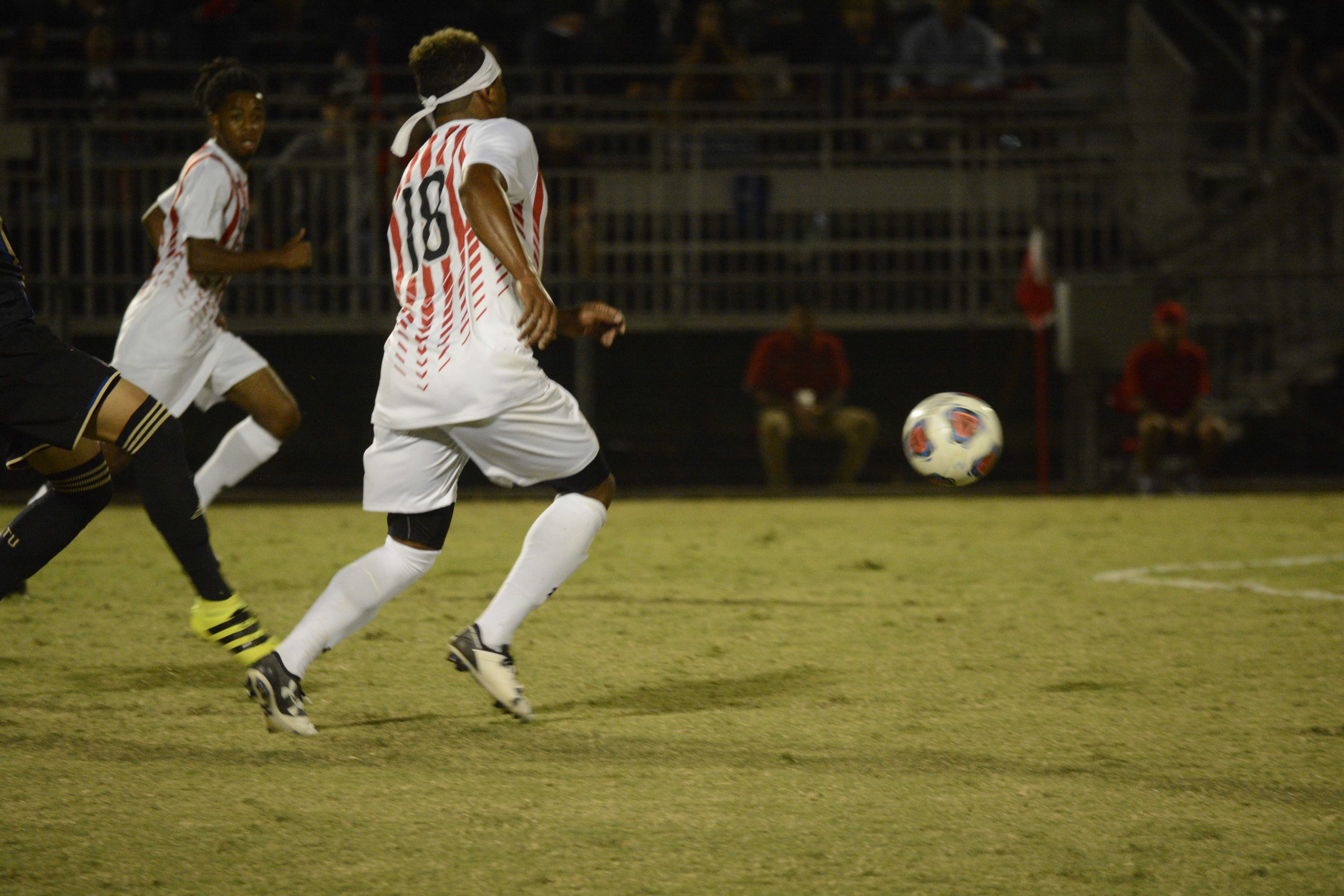 CSUN soccer players chase down the ball