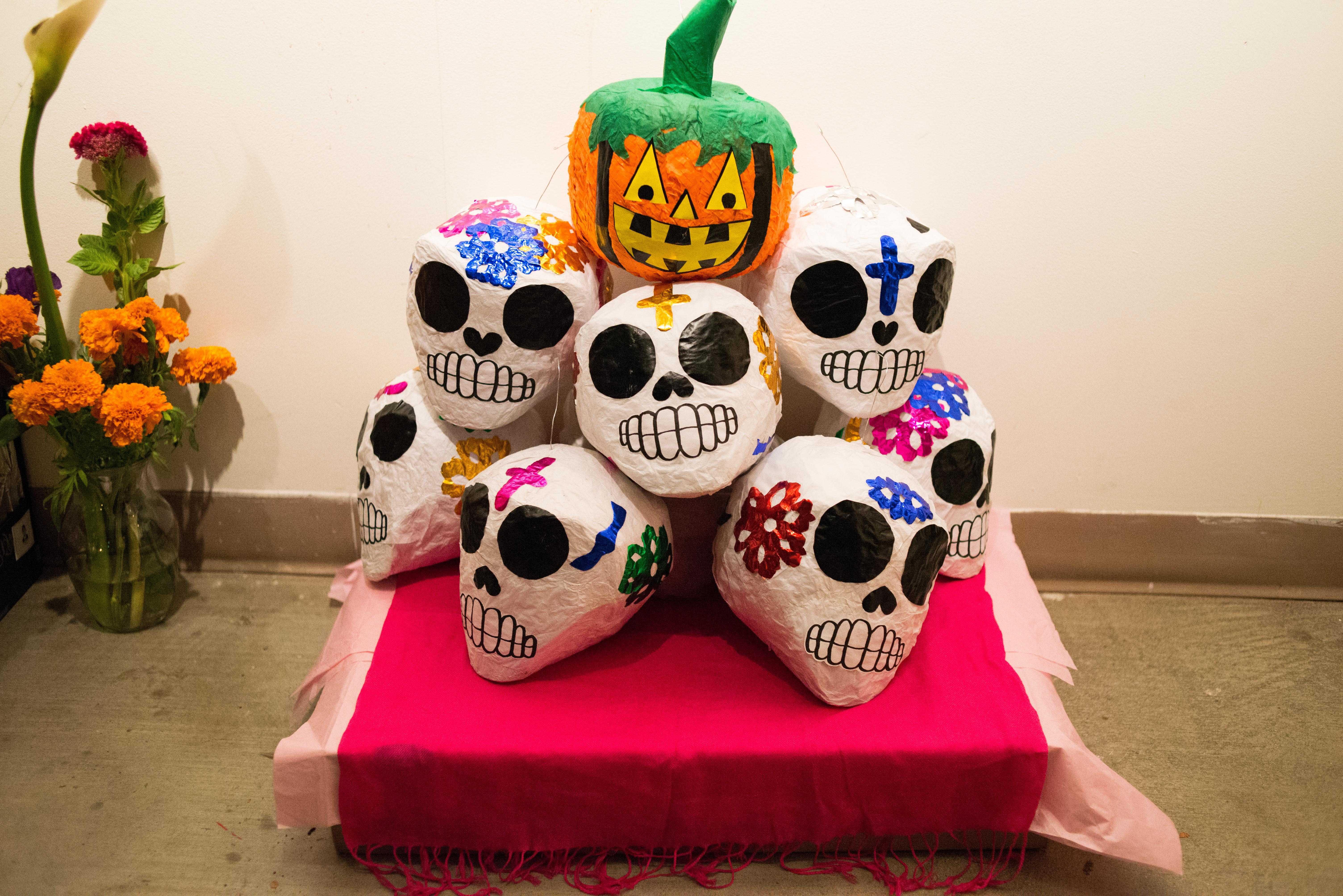 Alter shows paper skulls and jackolantern on alter