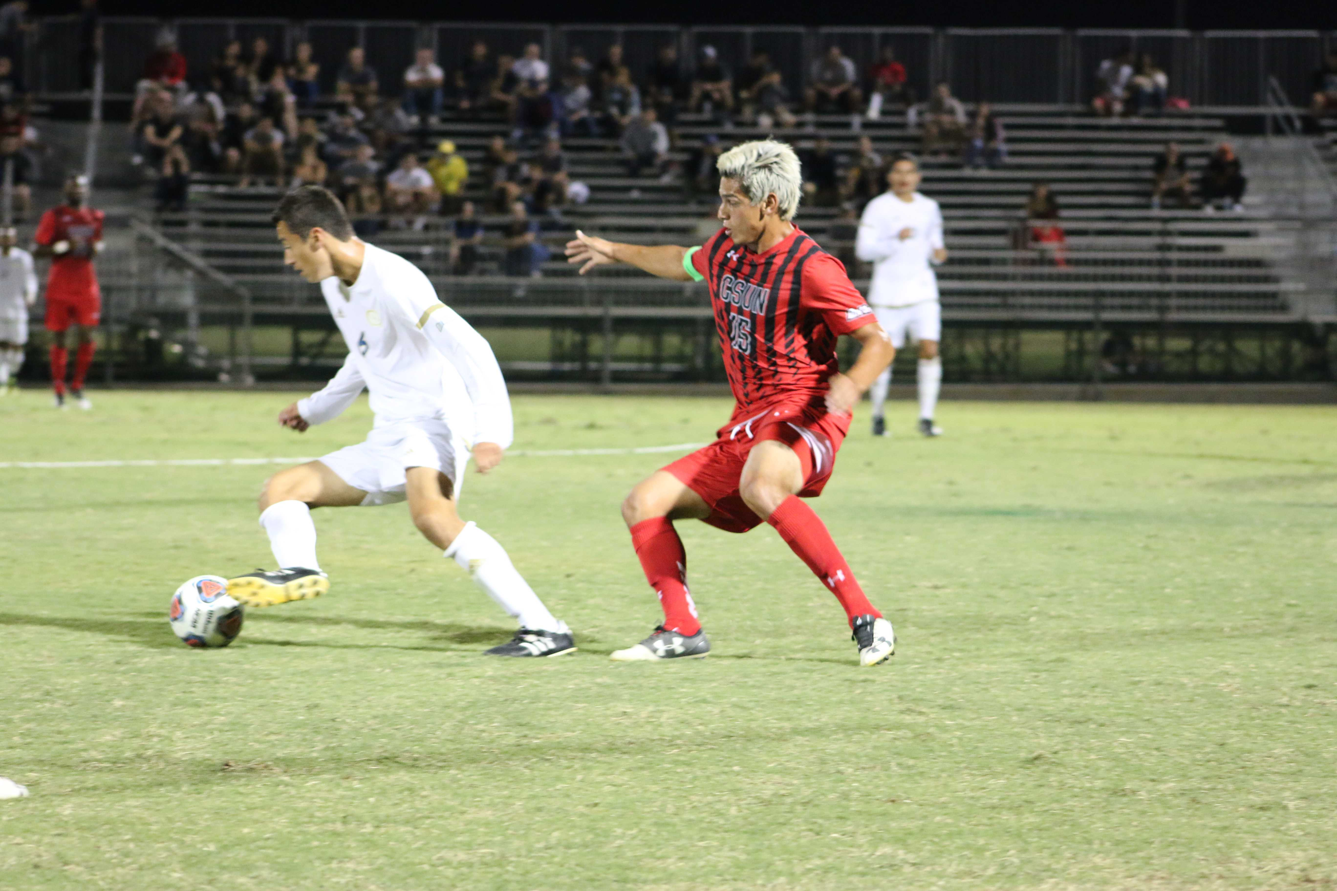 CSUN soccer player attempts to steal the ball