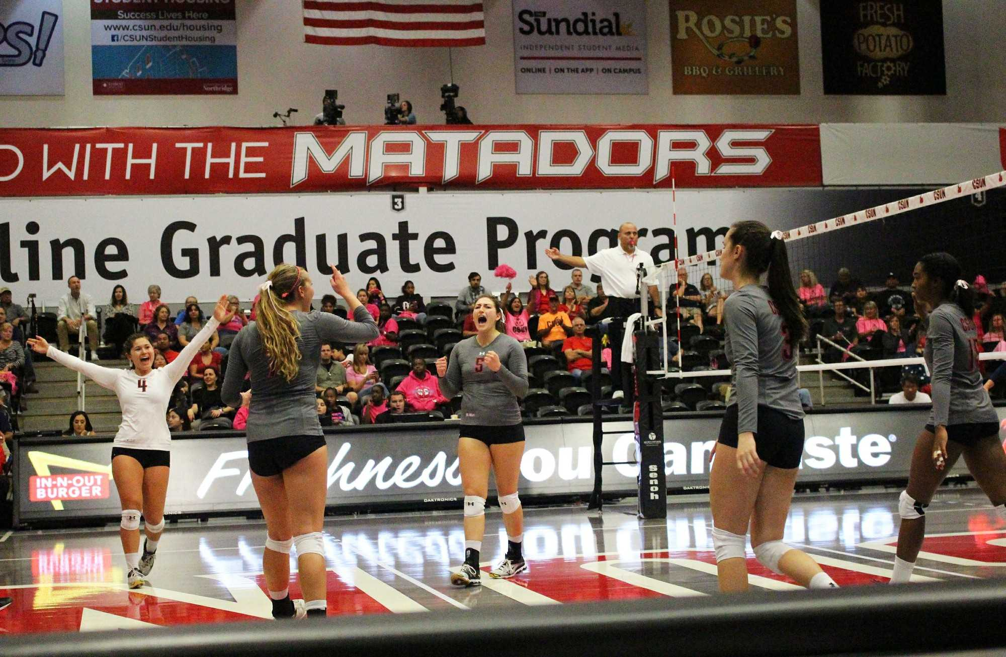 CSUN+volleyball+players+shout+for+joy+after+winning+a+point