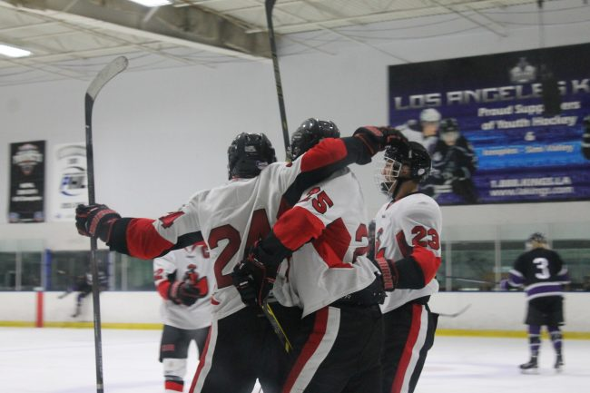 (23) Tereck Morales, (25) Andrew LaGaly celebrate (24) Eli Berengut's goal as (22) Alex Reints joins the fun Friday night at the Iceoplex of Simi Valley. Photo credit: Solomon Ladvienka