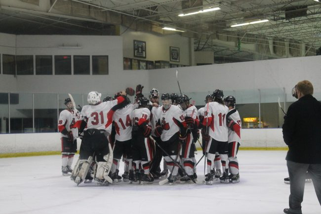 CSUN players come together as they celebrate their 6-2 win over GCU Friday night at the Iceoplex in Simi Valley. Photo credit: Solomon Ladvienka