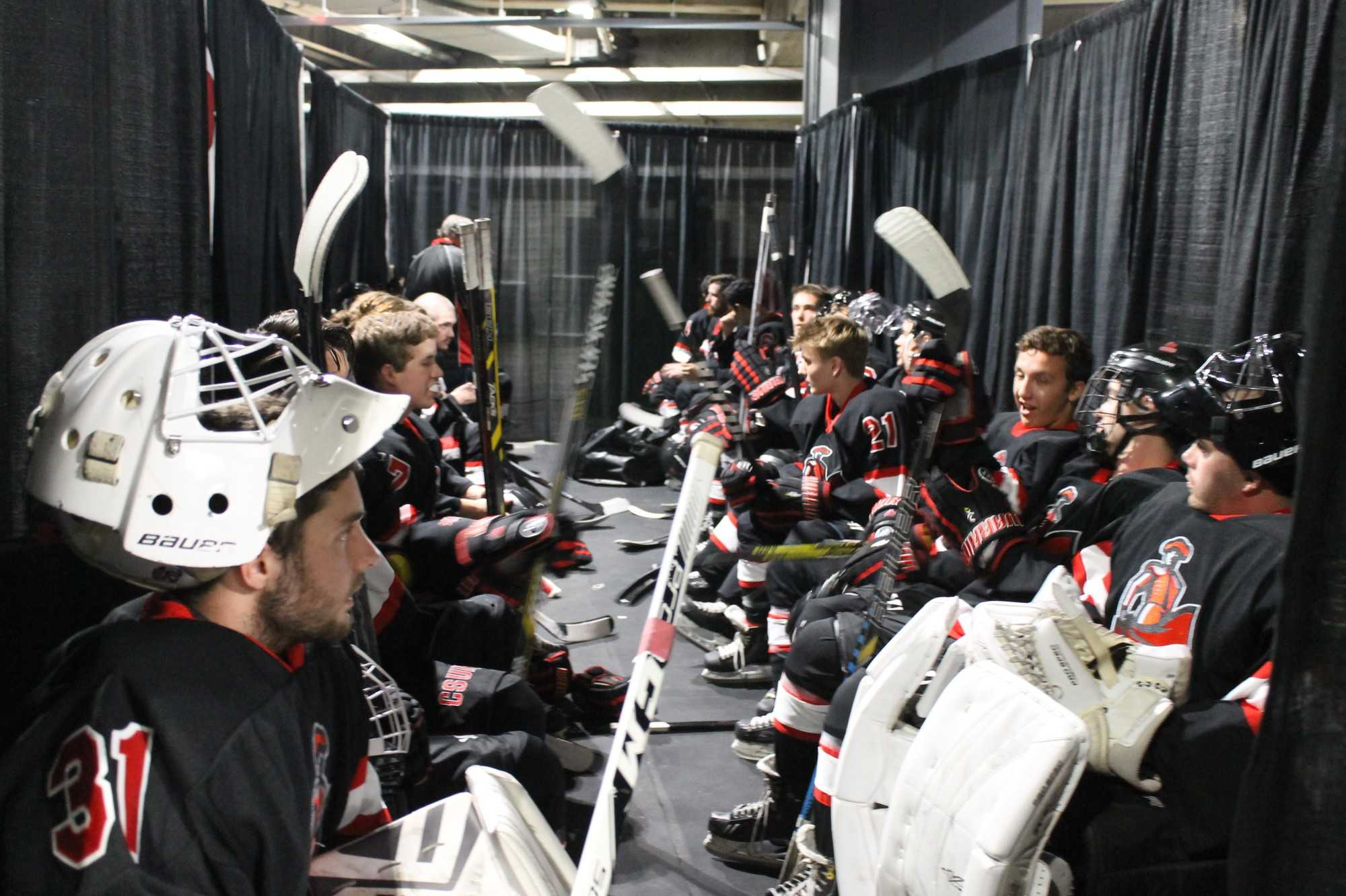 matador hockey team sits together before game