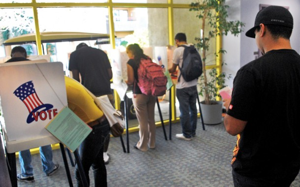 Student+voters+prepare+to+cast+their+votes+Tuesday+at+the+Satellite+Student+Union+polling+place+at+the+dorms.+Photo+Credit%3A+Armando+Ruiz+%2F+Staff+Photographer