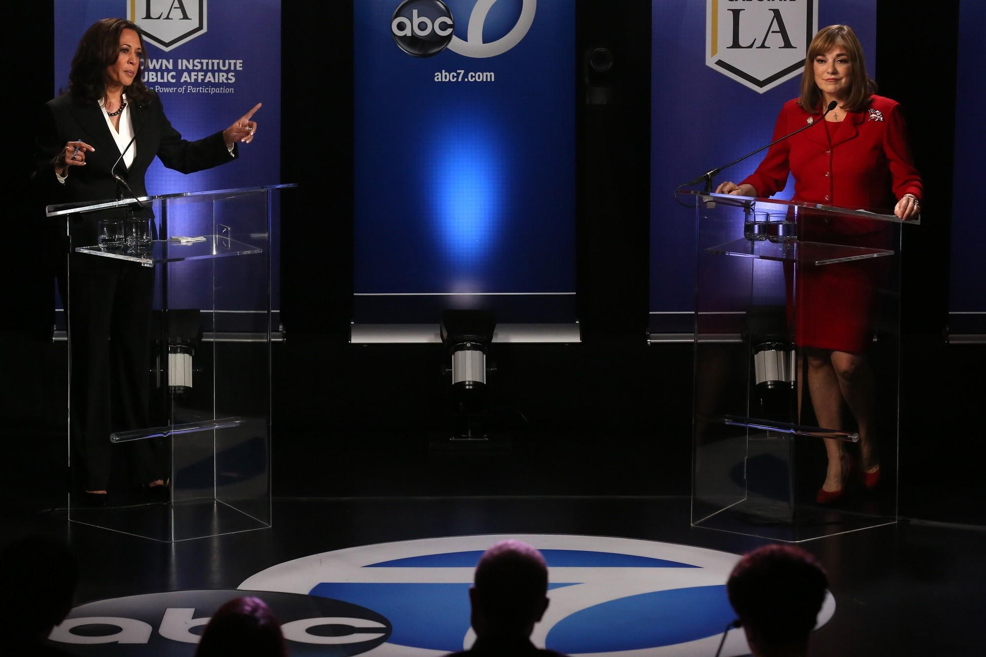 U.S. Senate candidate Kamala Harris, left, points a finger toward fellow candidate Loretta Sanchez during a debate