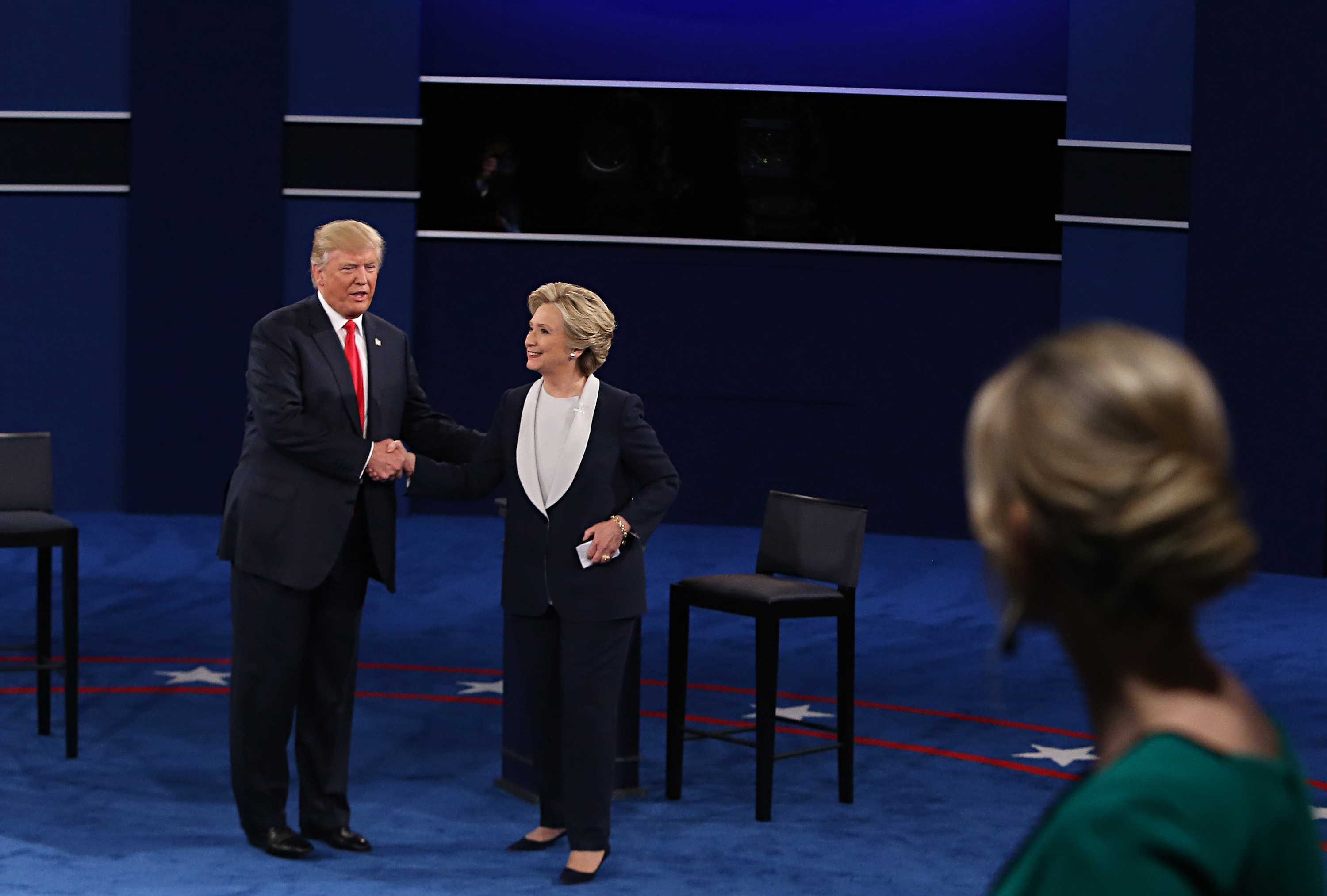 Trump and Clinton shake hands