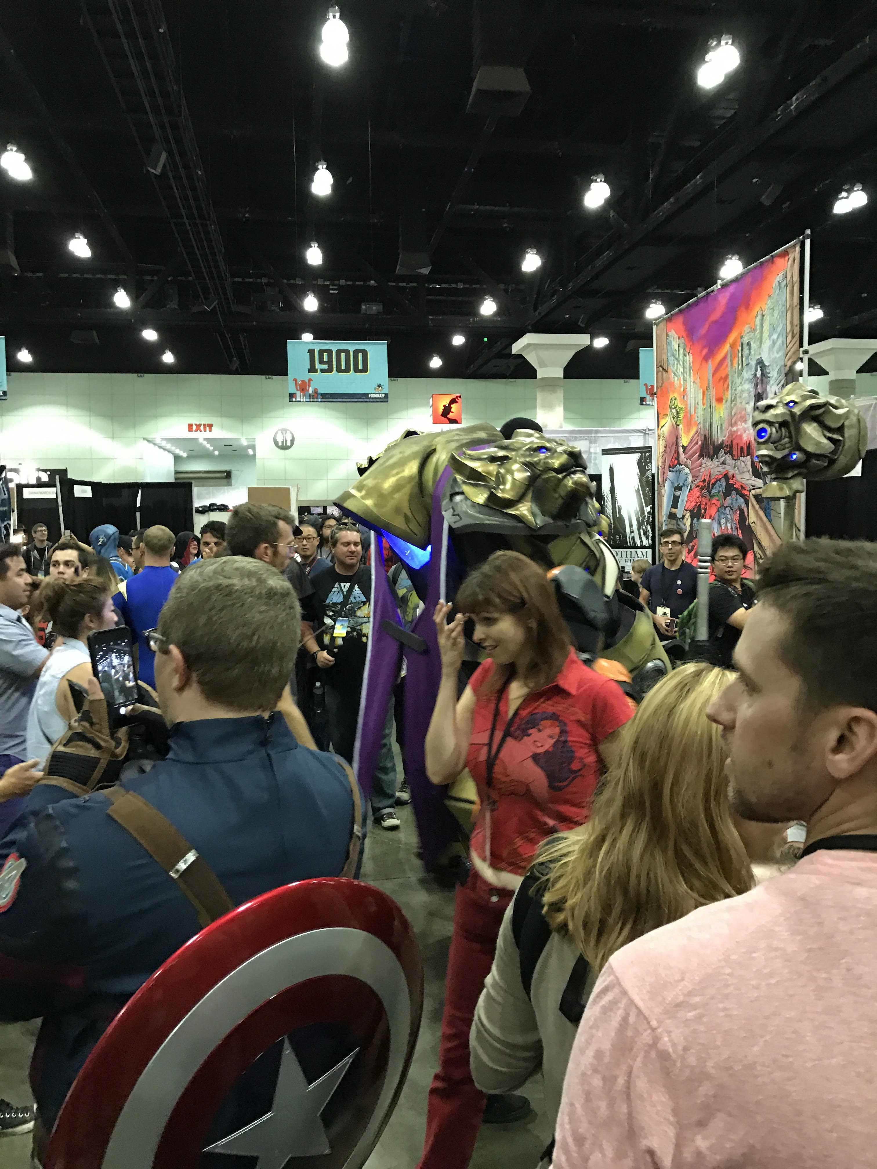 Photo shows man dressed as Captain America along with several other convention atendees