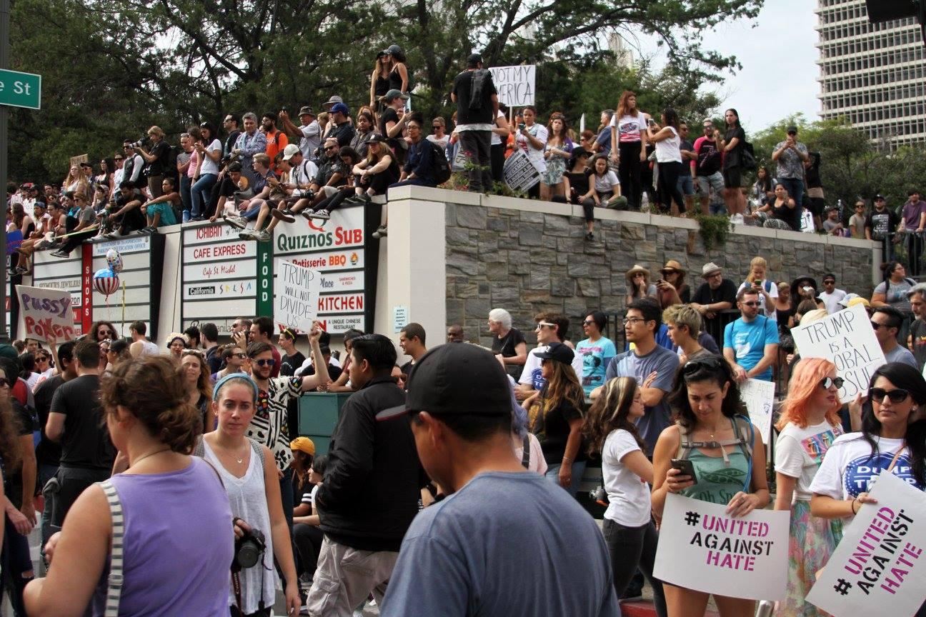 Anti-trump protesters fill a street corner