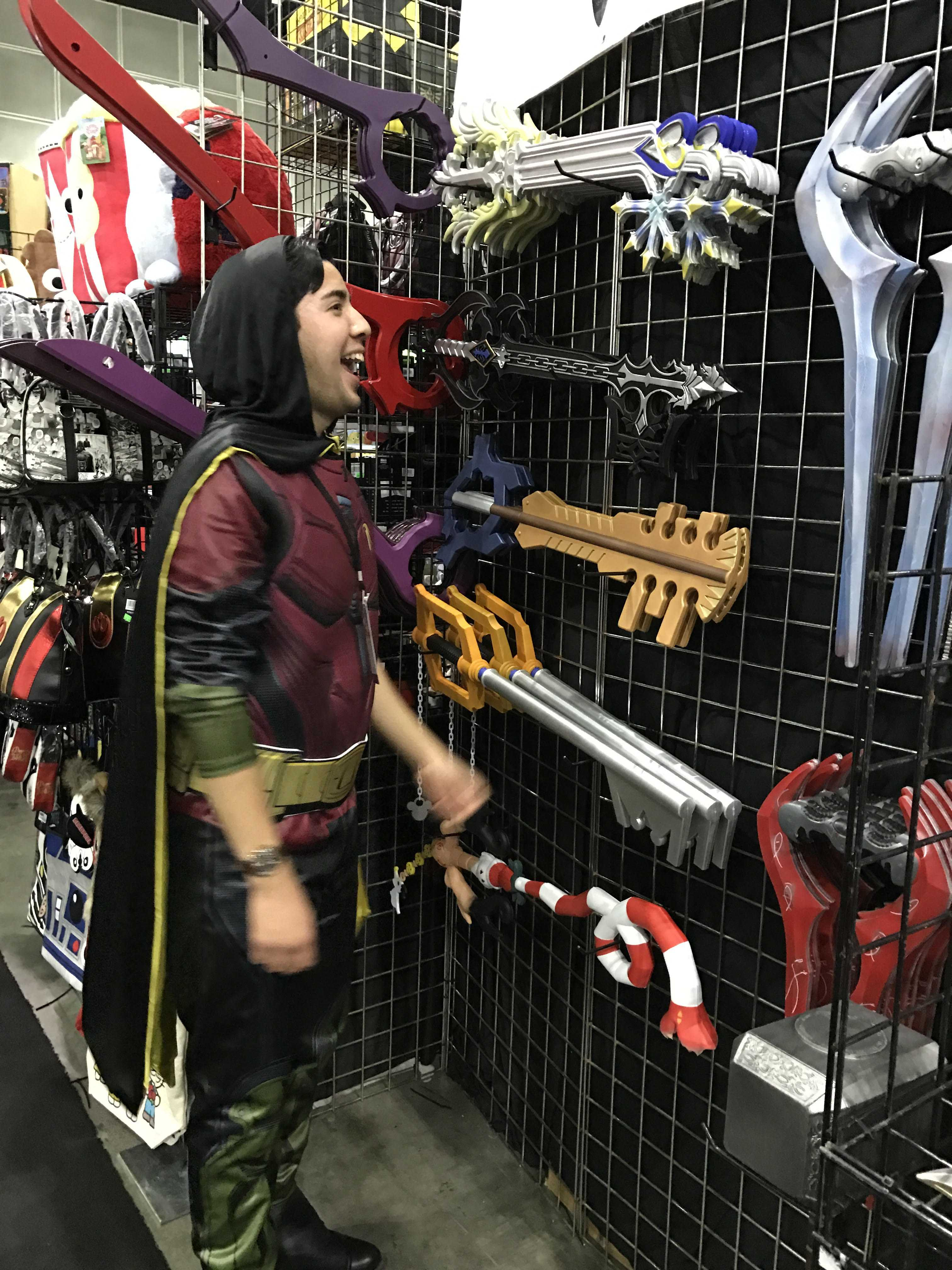 "Man dressed as Robin from Batman looks at key from the videogame ""Kingdom Hearts"""