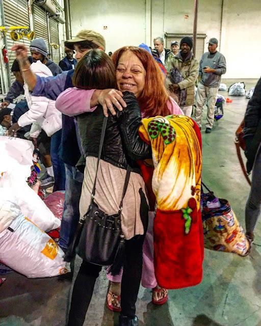 CSUN alumni, Angela Amhirkanian hugs homeless woman