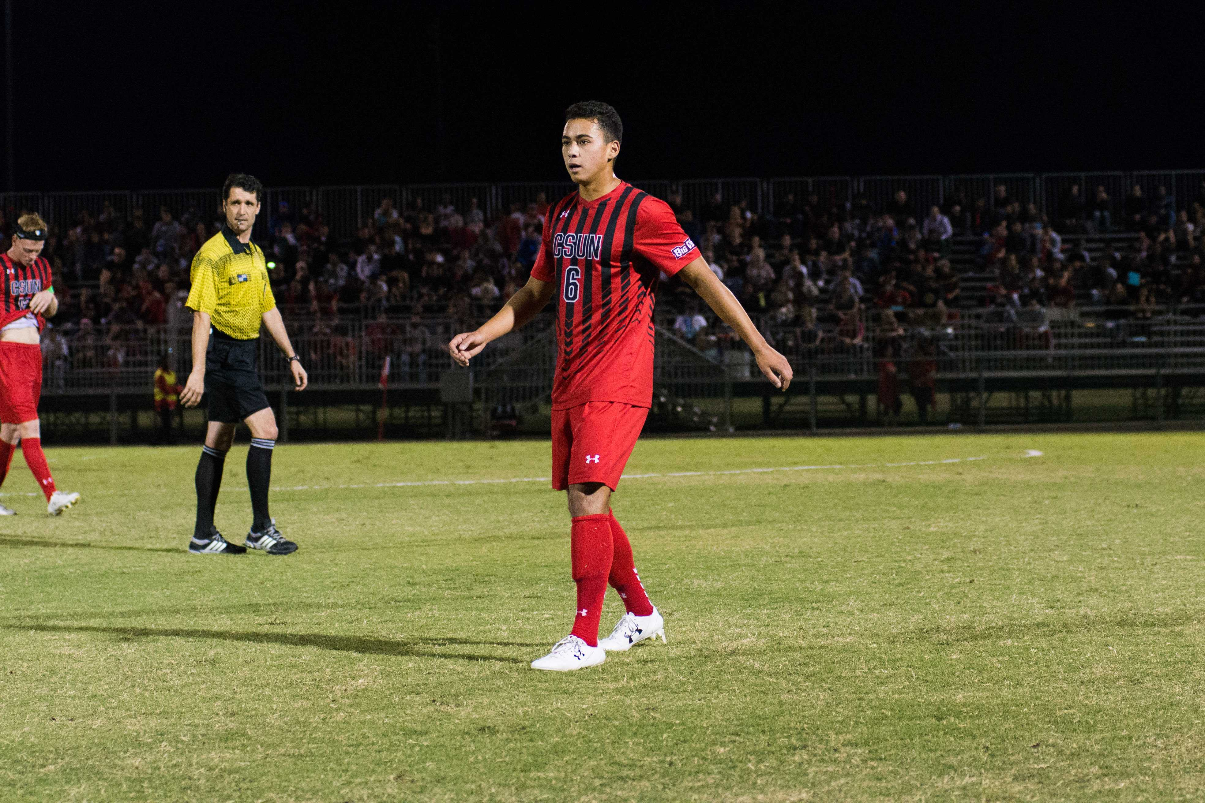 CSUN soccer player watches the field