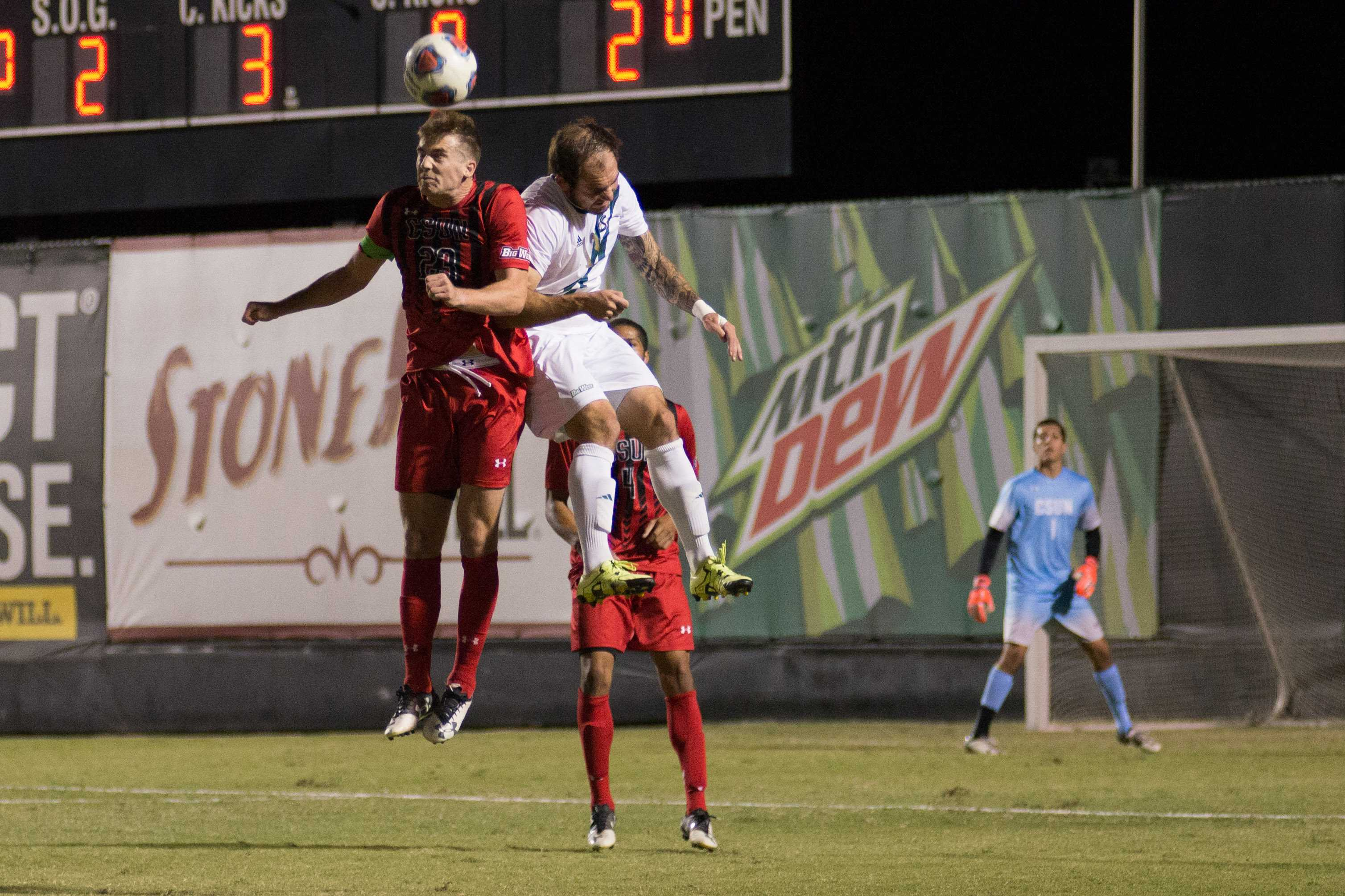 CSUN and CSUF player both jump up for header
