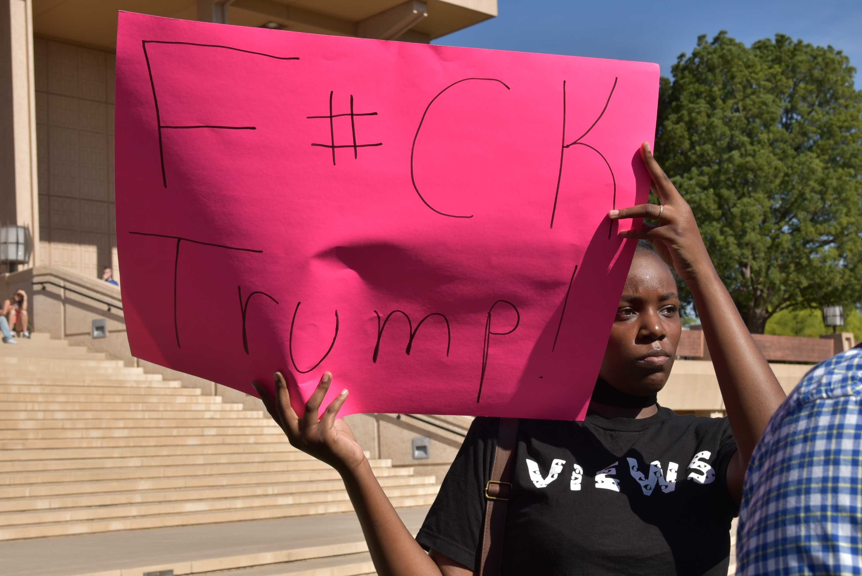 "Student holds up poster that says ""Fuck Trump"""
