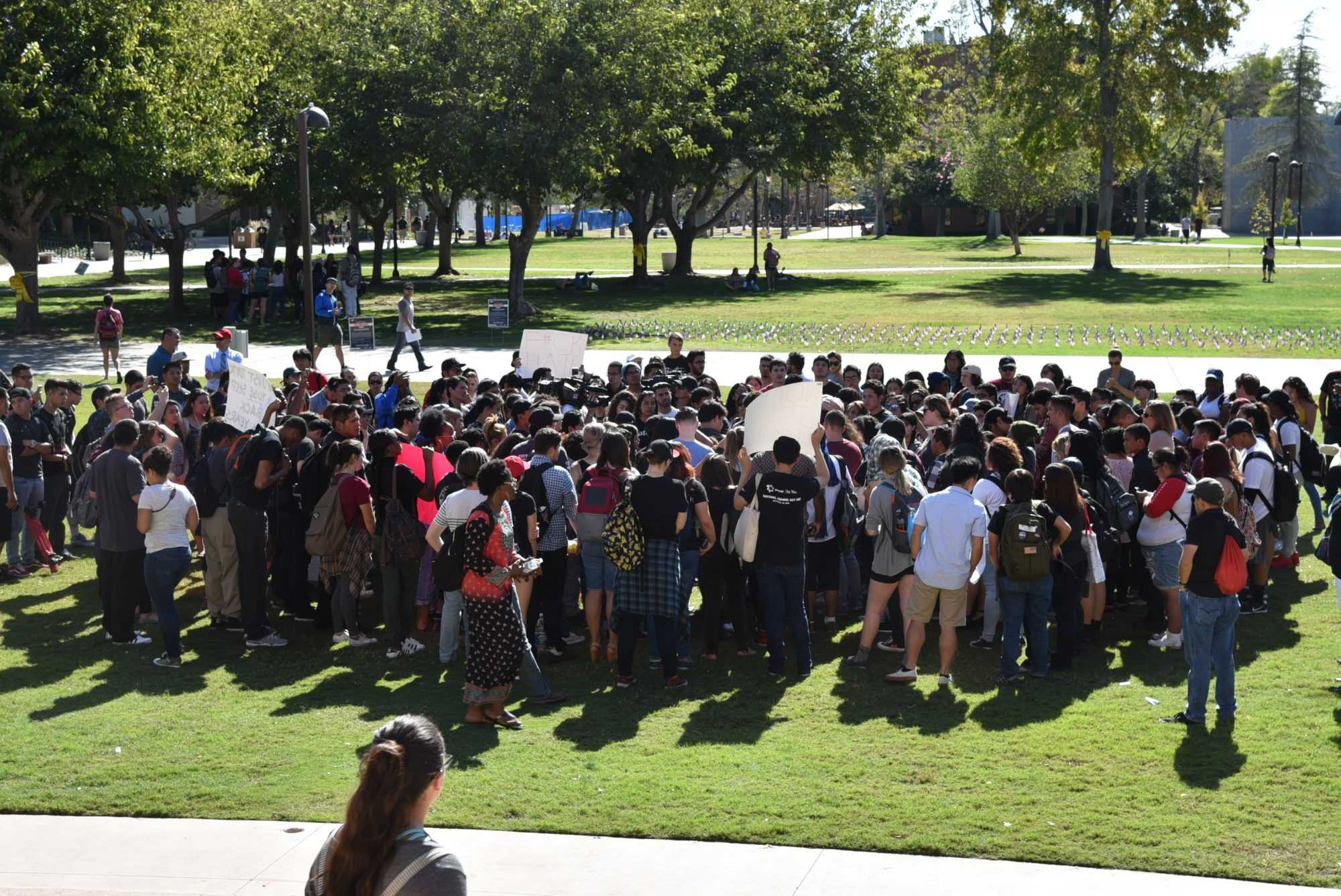 A group of students gathers in front of the Oviatt Library to protest Trump's election