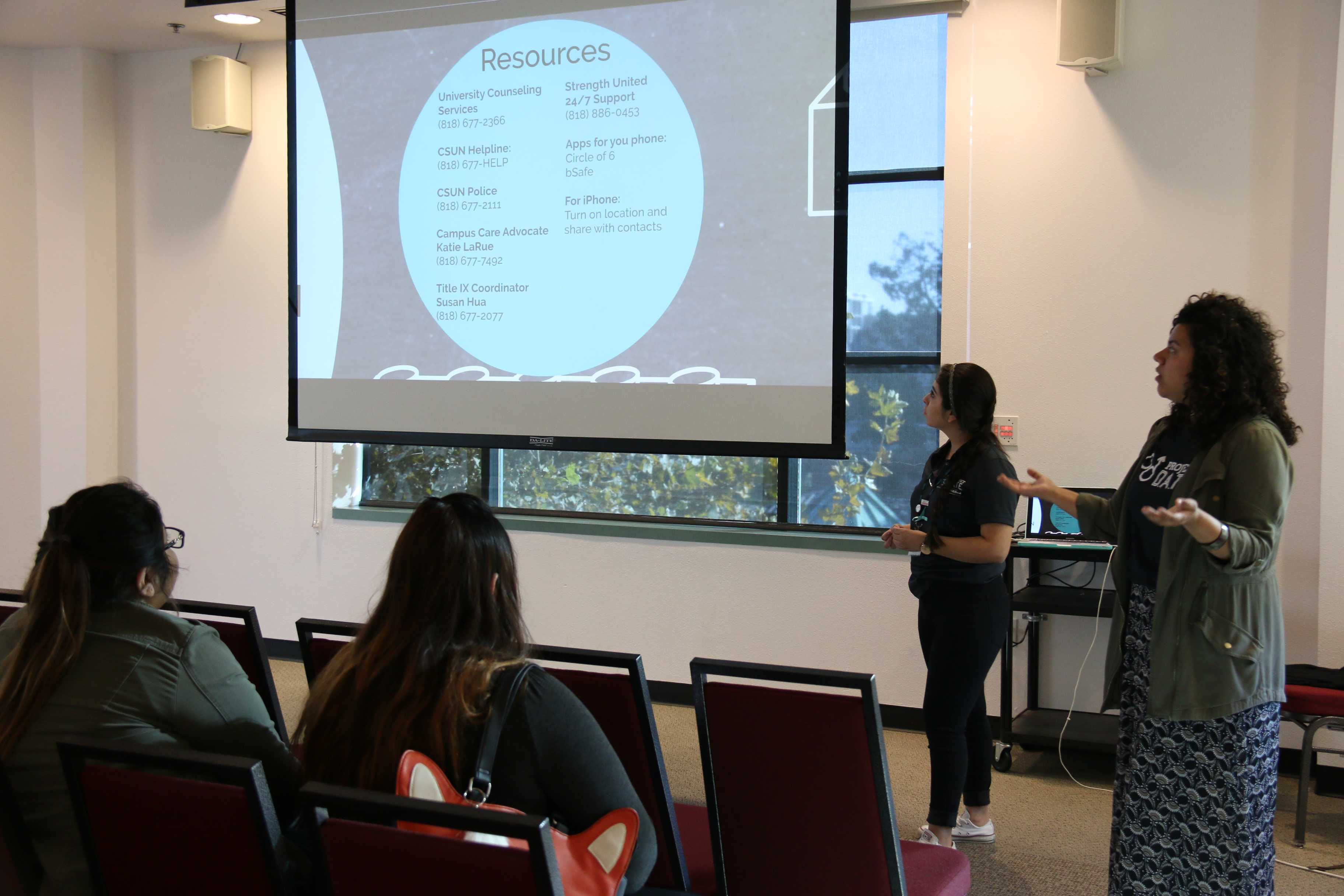 Anna Mendez and Andrea Gonzalez give a presentation to a small group of students