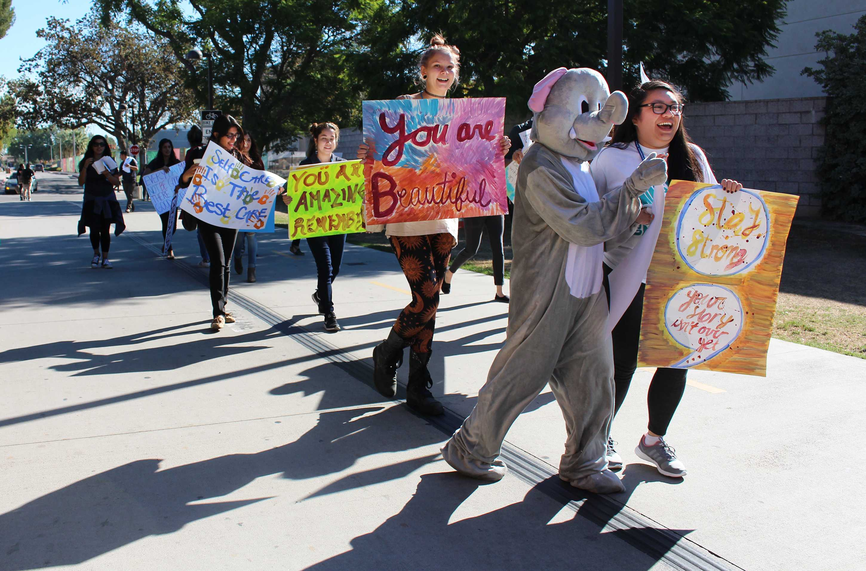Students+marched+in+front+of+Oviatt+Lawn+to+raise+awareness+of+mental+health+in+college